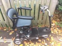 For sale Tga minimo folding lightweight mobility scooter with bracket for car hoist.