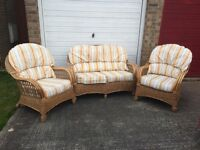 Cane furniture consisting of two arm chairs and a two seater sofa