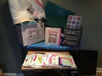 Singer sewing machine (brand new never used) plus the art of quilting series plus extras
