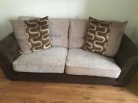 Brown and cream sofa and swivel chair