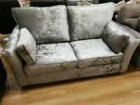 Silver velvet 2 seater sofa with side cushions