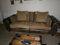 Large lounge suite consiting of 4 seater sofa, 3 seater soafe and pouffe.