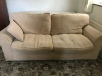 cream sofa bed. Spring loaded and double size. Smoke and pet free home.