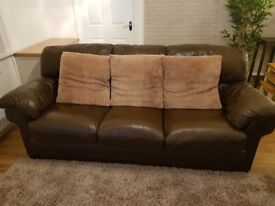 Brown leather settee and chair