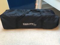 Excellent condition Kiddicare Travel Cot with extra mattress.