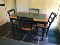 Green tiled dining table and chairs