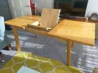 Extendable pine dining table seats 4 to 8 people. EXCELLENT CONDITION. COLLECTION ONLY.