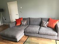 Nearly new L-shape sofa in grey fabric