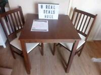 Brand new solid wood table and chairs set RRP £110