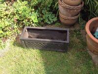 Resin plant pot trough for the garden
