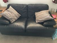 Leather sofa set free to a new home. 2 seater and 3 seater black leather sofas.
