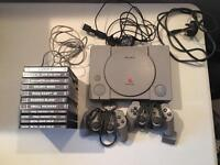 Sony PlayStation 1 original vintage collectible games console with 9 games and controllers.