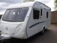 2008 Swift Charisma 535 fixed bed 4 berth caravan with SunnCamp Awning. Cris. registered.