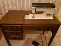 Sewing machine and built in table