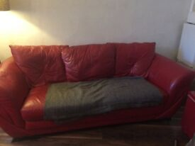 Red leather sofa in good condition.