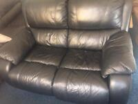 Black leather sofa . Can deliver