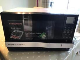 Steam and grill microwave