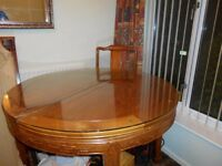 Solid wood with optional glass top. Extending dining table and six chairs