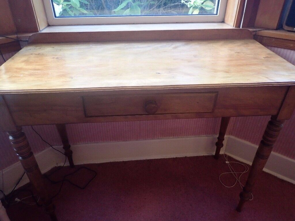 Small table/desk. Great for a laptop work area.