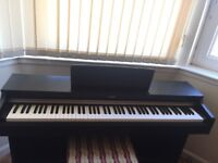 Yamaha digital ARIUS YPD 162 piano and stool