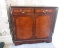 2 door cupboard in dark wood mahog or walnut