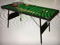 6ft Pool/Snooker table. Folds away, 2 cues, both sets balls triangles and scorer. Good condition.