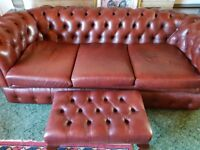Brown Chesterfield sofa with matching Queen Anne chairs and foot stool