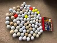 Various golf balls and tees