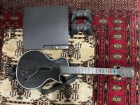 PlayStation 3 Slim 120GB with 45 games, two controllers, Guitar Hero Guitar