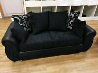Black fabric and faux leather 2 seater sofa with scatterback cushion design