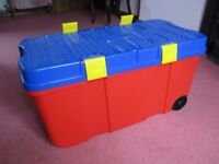 Super Child's Wheel-Along Very Large Red Play Storage Box with Blue Play Top and Yellow Clips
