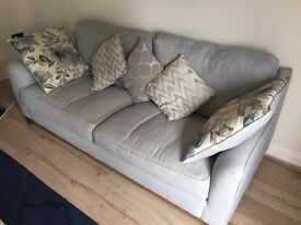 Beautiful pale blue fabric 3 seater sofa with cushions