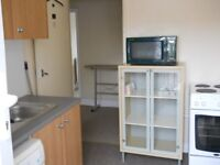 FREEHOLD INVESTMENT For sale hot food takeaway shop and self contain flat.