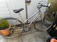 Vintage ladies gold peugeot racing bike with lock