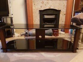 New John Lewis smoked glass TV unit with dark wood finish.