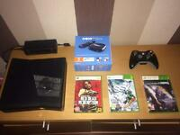 Xbox 360 slim including games & now TV box + subscription