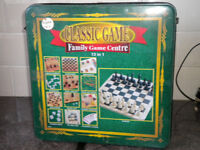 tin box with a vairtiay of games in cards dominos etc