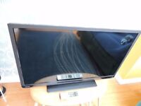 """TOSHIBA 32"""" LCD SMART TV ON STAND. HARDLY USED. VGC. £80 ONO"""