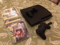 Sony PlayStation 3 Slim Console + 2 controllers and 12 games.