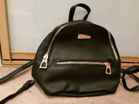 Womens small black backpack (never used) and red over shoulder bag