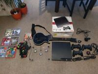 PS3 Console slim 600 GB hard drive with 7 games