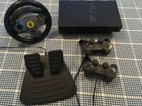 Playstation 2 with foot pedal, steering wheel, two controllers and a selection of games