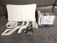 Nintendo Wii console with ten games and Wii Fit board