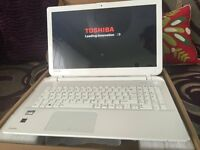 IN MINT CONDITION TOSHIBA LAPTOP BOXED