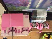 Boxed pink PlayStation 2 Ps2 bundle with games mics buzzers