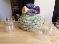 Gorgeous glass teapot, crocheted cosy, 4x glass cups plus warmer
