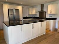 Fitted kitchen Cream Shaker style units and appliances