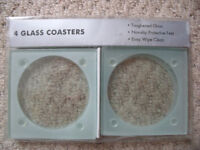 NEW 4 toughened glass coasters in original sealed packaging. Non-slip protective feet. £2.