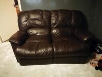 Pair of brown leather sofas bit of wear and tear on the 2 seater
