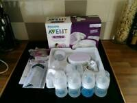 Avent electric breast pump with 4 anti colic bottles&teats.